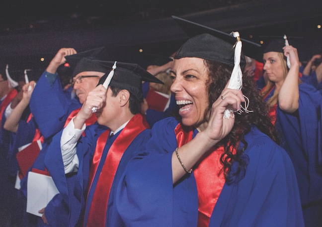 "Adult learners celebrate graduation at DePaul University in Chicago. The school has focused on simplifying the application and admissions process to accommodate ""nontraditional"" students."