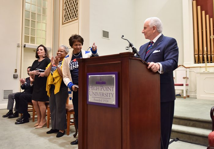 Phyllis Worthy Dawkins, Bennett College president, gives High Point University President Nido Qubein a thumbs up as they speak to a crowd of Bennett and High Point students inside HPU's chapel, where Qubein made HPU's $1 million contribution. announcement.