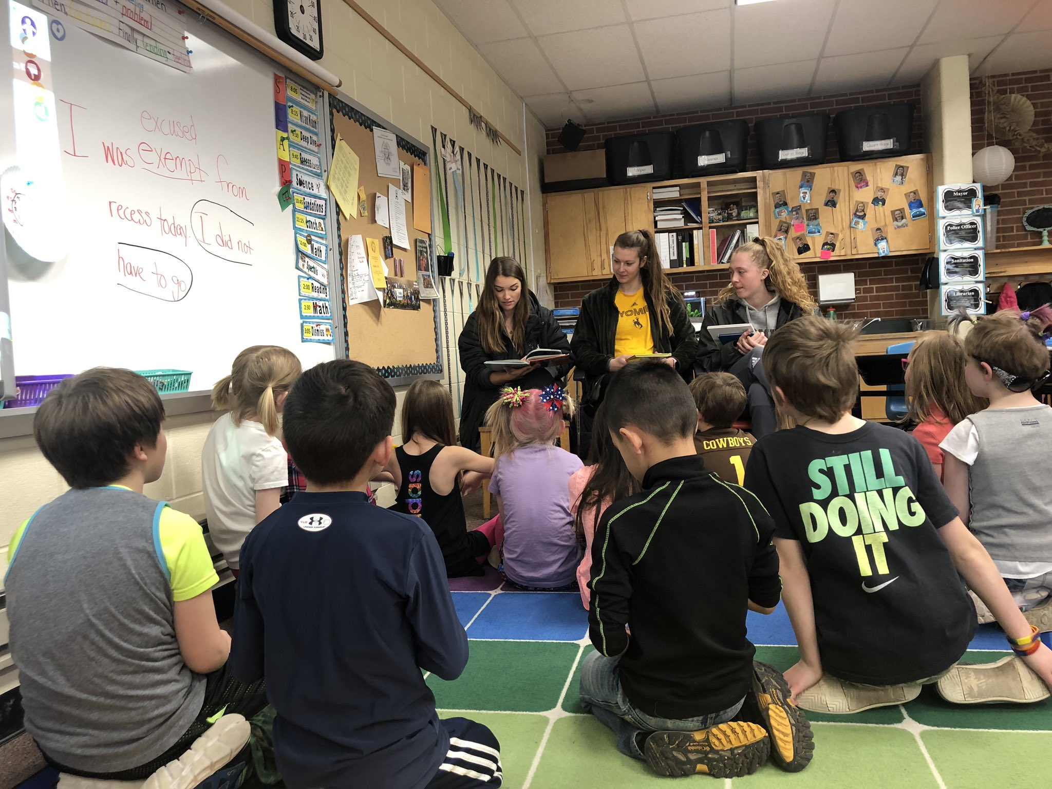 University of Wyoming student-athletes read to Beitel Elementary children as a part of a community service project.