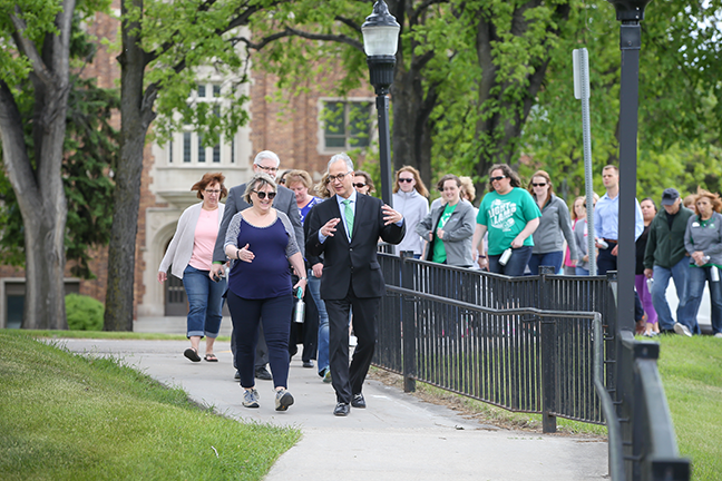 LEADING THE CHARGE—University of North Dakota President Mark Kennedy (front, right) leverages his corporate and congressional careers in managing a major employer and sustaining political and community support for the university.