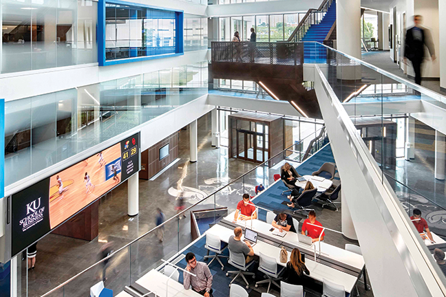 Impact on entry—The atrium of Capitol Federal Hall, opened in 2016 as The University of Kansas' business school facility, features a video wall completed just in time for the ribbon-cutting.
