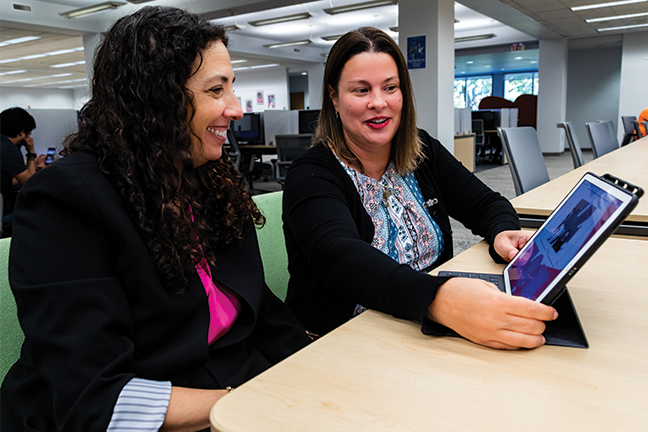 Instruction production—Dawn Dubriel (right), an instructional designer at Lynn University, helps faculty such as criminal justice professor Sindee Kerker create lesson plans using instructional apps for iPad Pro. Instructional designers produce videos with professors and teach them how to do it themselves.