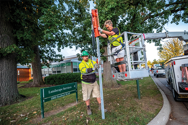 On solid ground—Michigan State University's landscape and grounds team is responsible for maintaining 1,500 acres of green space, 57 miles of roadways and 22,000 trees. Among the department's many services is the installation of roadway and wayfinding signage.