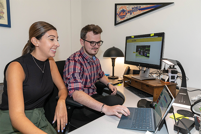 ASSISTING WITH TECH—Liam Owens, the assistive technology specialist at Adelphi University, works with students to show them how various tech-based accommodations can help manage challenges related to their disabilities.