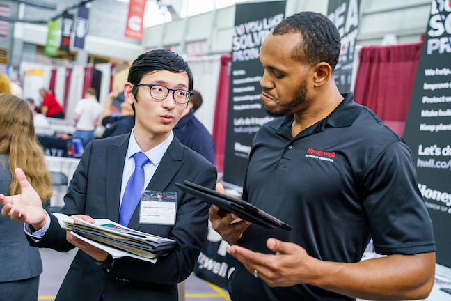 A student speaks with a potential employer at a career fair at Rose-Hulman Institute of Technology. Enrollment of Chinese college students at the Indiana institution, which has about 2,000 undergrad students, dropped by about 40 this year.