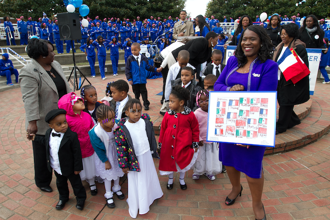 Tennessee State University President Brenda Baskin Glover celebrates learning with some young students.