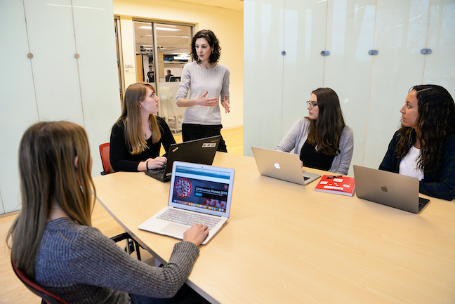 Sacred Heart University Professor Sofia Pendley (standing) is leading students in generating weekly coronavirus reports for local health officials. (Photo: Tracy Deer-Mirek)