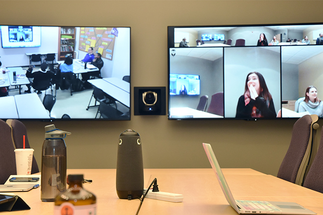 At Kansas State University's Olathe campus, several rooms are equipped with automatic tracking cameras and ceiling mics, which means presenters don't have to worry about attaching lapel mics or using other devices.
