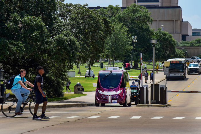 Texas A&M has tested self-driving shuttles (pictured) on a fixed course amid routine pedestrian and cycling traffic as part of its initiatives to create a more connected and walkable campus.