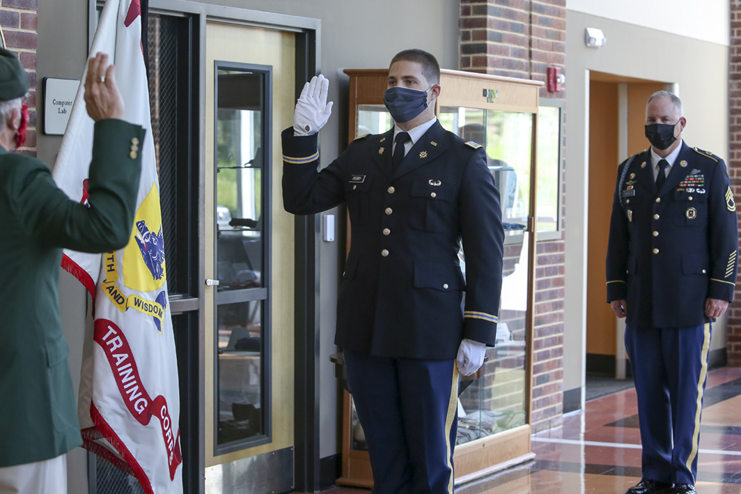 A University of North Georgia cadet commissions on campus in accordance with CDC guidelines on social distancing.