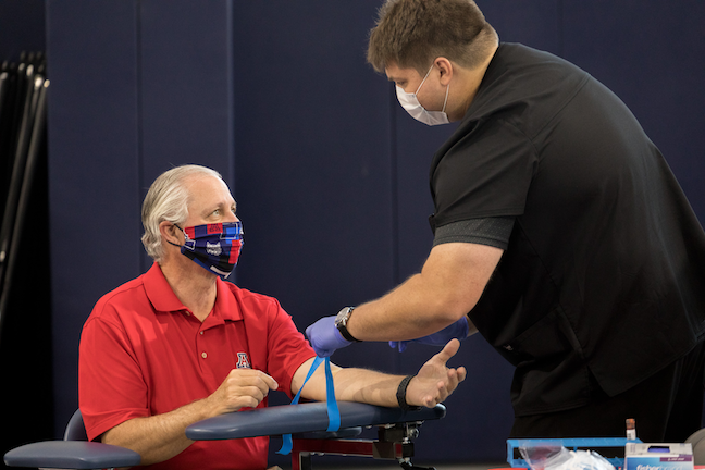 University of Arizona President Robert C. Robbins gets blood drawn for a coronavirus antibody test at an event where he also announced in-person classes would resume on Aug. 24.