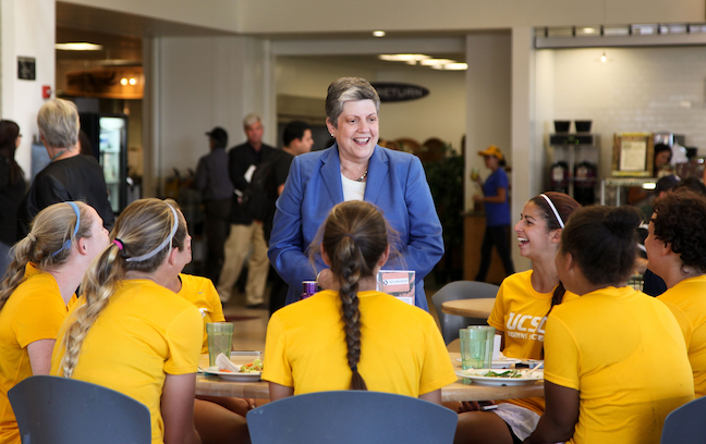University of California President Janet Napolitano, shown here with the University of California, Santa Cruz women's soccer team, wants the system to drop SAT and ACT scores as admissions requirements.
