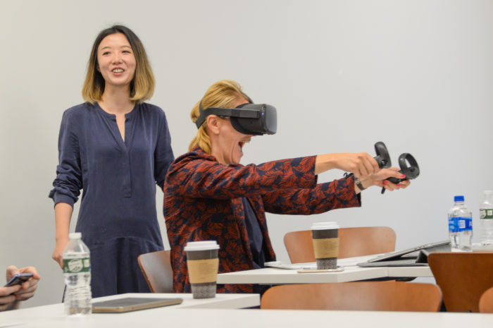 MBA students visiting from Sacred Heart University's Luxembourg campus participate in a virtual reality workshop with SCMA professor Shanshan Wang at West Campus. Photo by Tracy Deer-Mirek 8/12/19