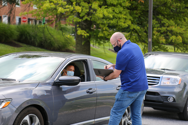 During this week's move-in at McDaniel College, students reserved an arrival time and then remained in their cars as they checked in for fall the semester at the school's stadium.