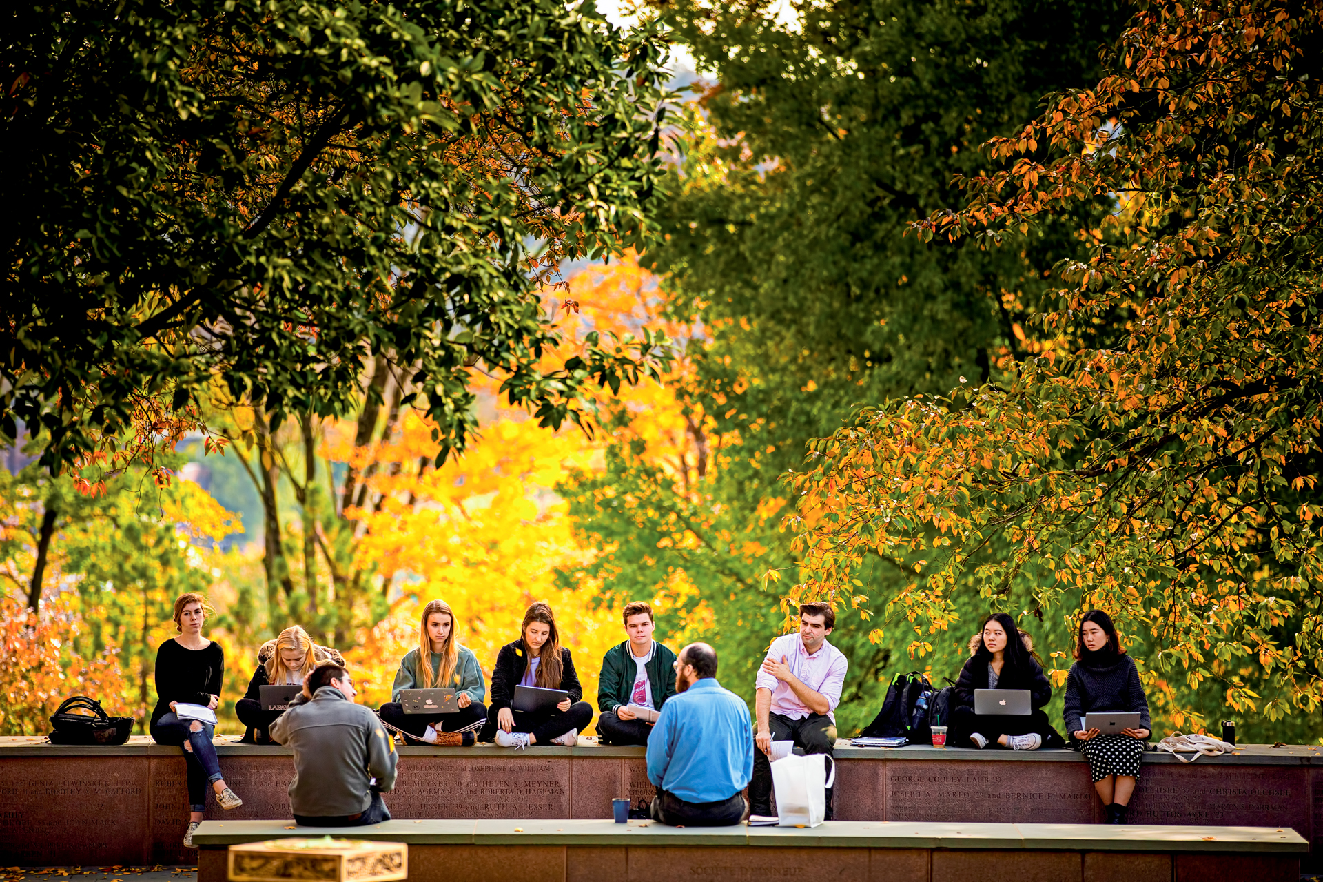 Students at Lafayette College attend a class outdoors.