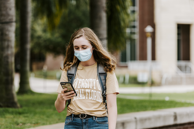 A student at the University of Central Florida self-assesses for COVID symptoms with the school's mobile app