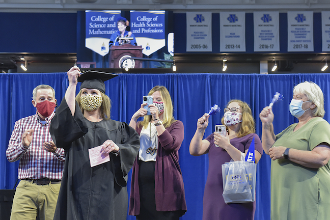 Organizers assigned each family to a taped-off box for social distancing at the at a recent the University of North Georgia's recent commencement ceremony for spring and summer graduates.