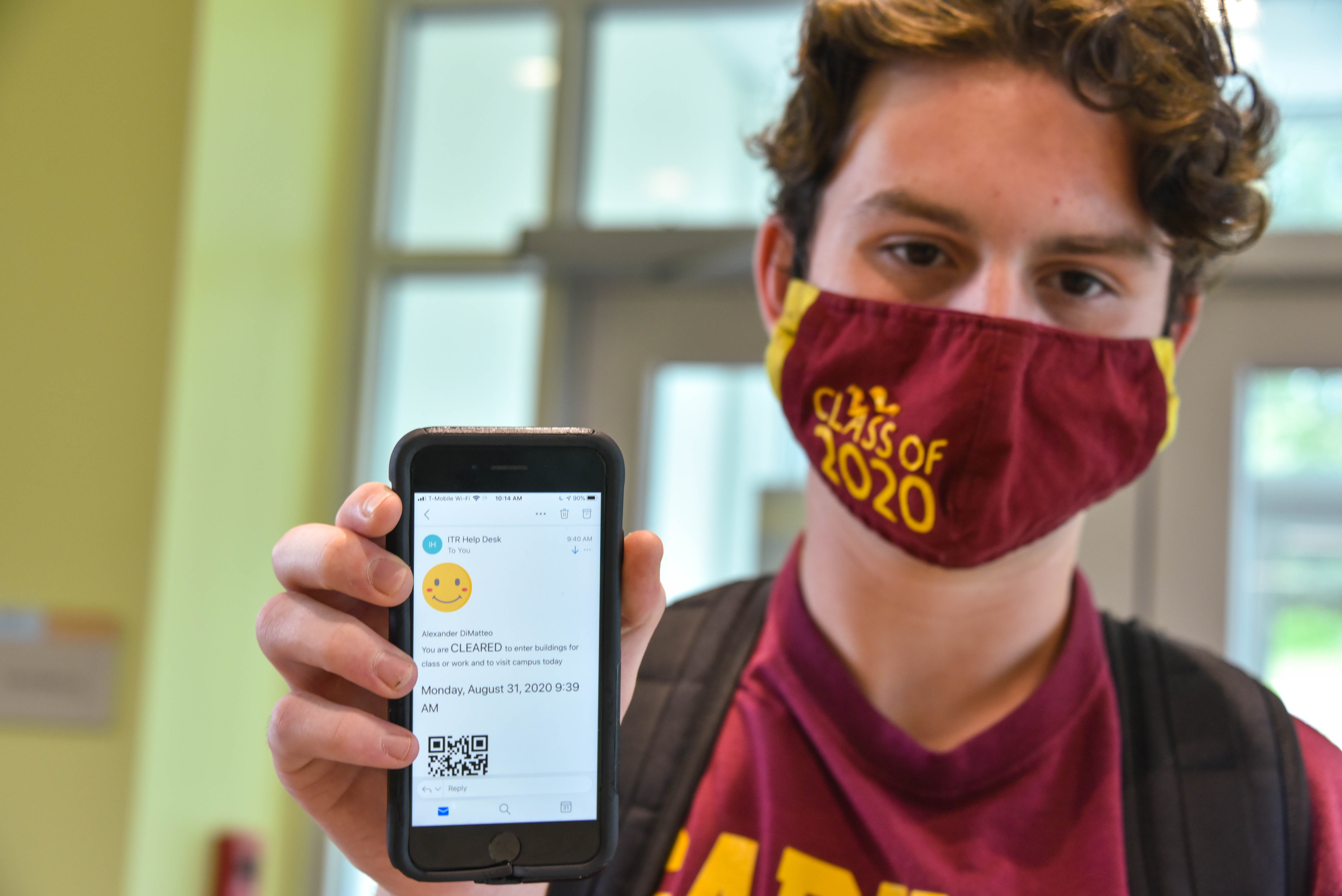 A Neumann University student participates in a daily health screening.