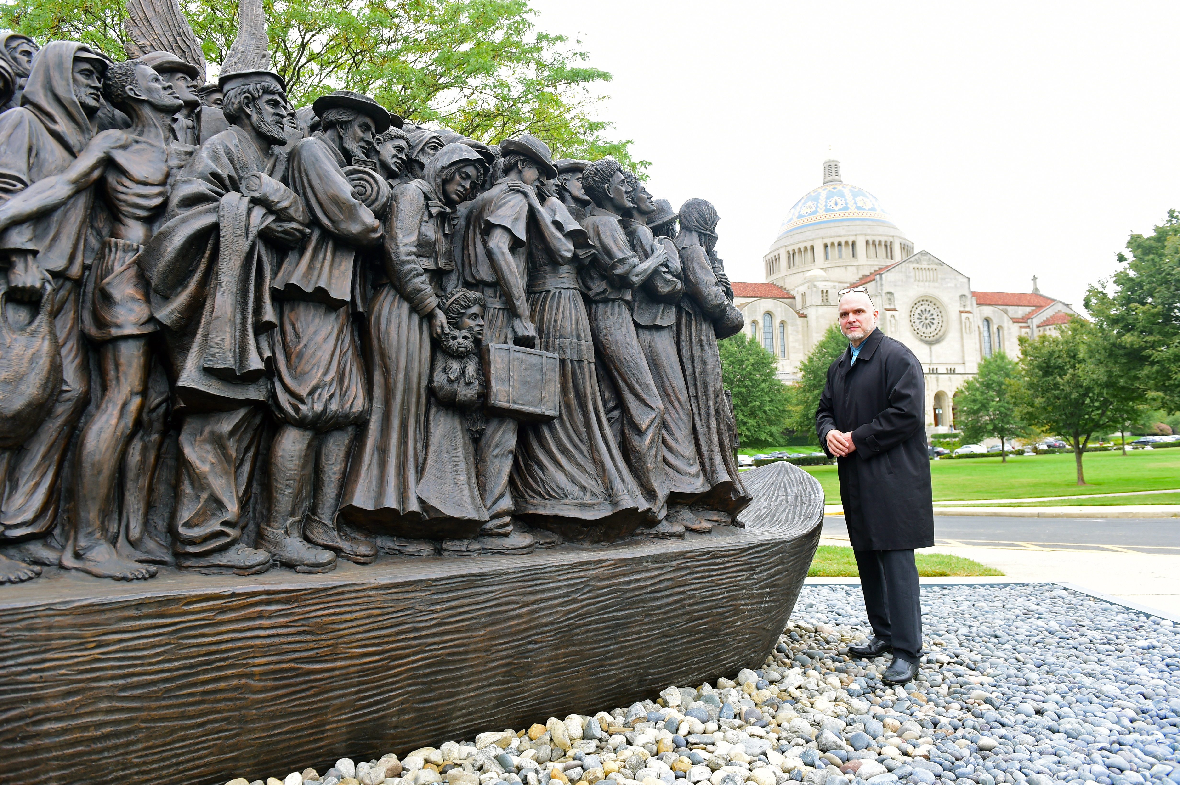 Sculptor Timothy Schmalz with his statue, called Angels Unawares. Photo: Patrick G Ryan, Catholic University Photographer
