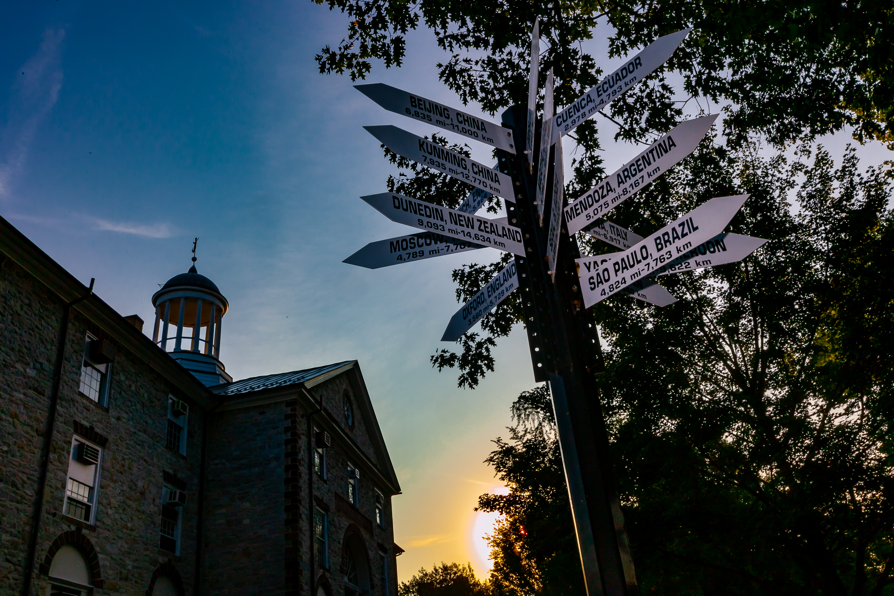 A signpost on Dickinson's academic quad lists the distance between the Carlisle, Pa. campus and various points around the world. It serves as a symbol of how global study and engagement is a cornerstone of the Dickinson experience.