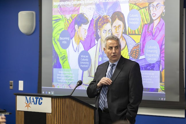 Mohammad Dakwar, Milwaukee Area Technical College's vice president of learning, speaks to campus employees about the school becoming a Hispanic-serving institution institution.