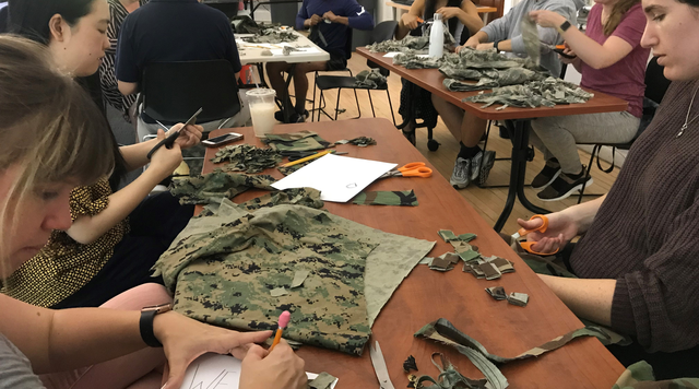 A group of Columbia University students, including former service members, connect while making paper out of old uniforms.
