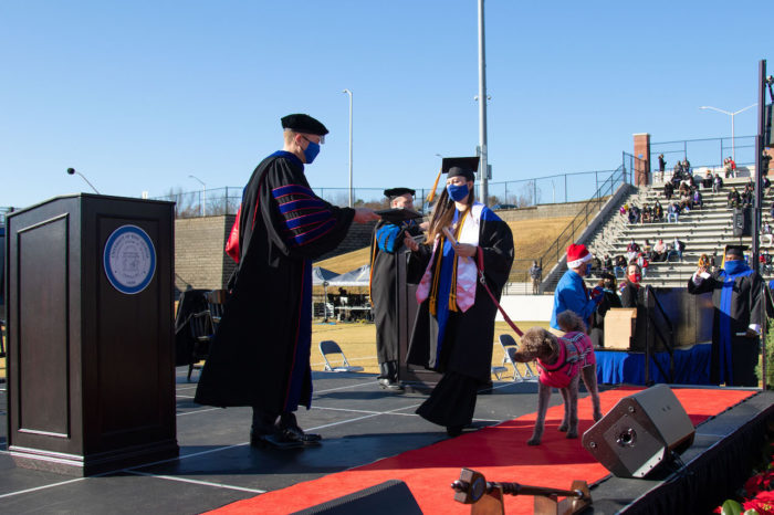 Maggie Leptrone and her diabetic alert dog, Mona, crossed the University of West Georgia commencement stage on Saturday to receive their degrees from President Brendan B. Kelly.