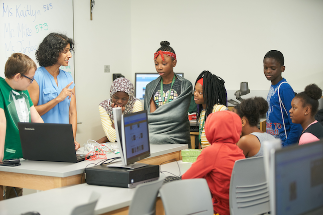 """Le Moyne College runs a """"quantitative thinking village"""" summer camps where Syracuse middle schoolers work on projects such as building robots and debugging computer programs."""