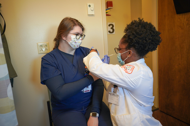 Students deliver COVID vaccines at the University of Tennessee Health Science Center.