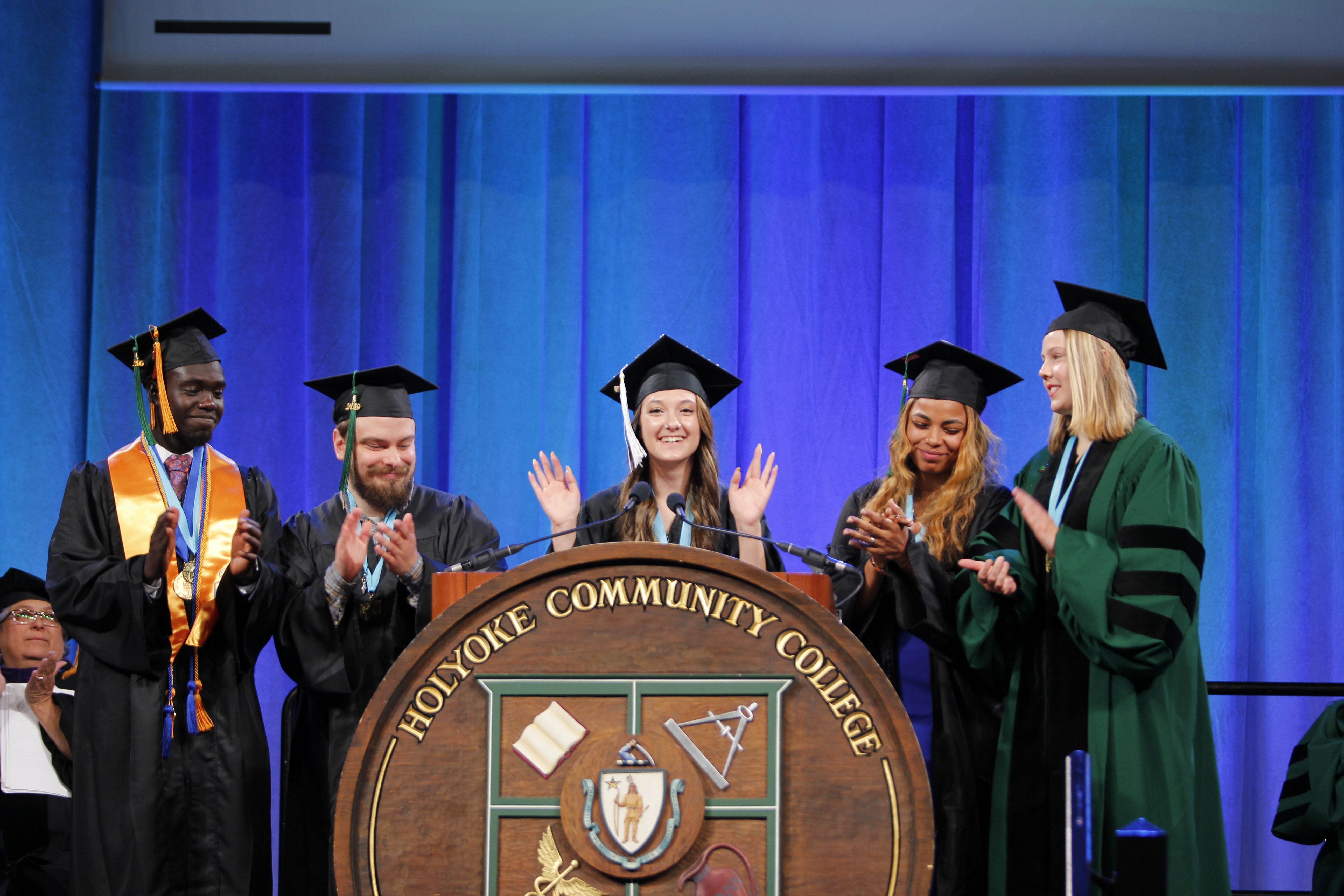 A group of students leaders at Holyoke Community College presents the class gift during Commencement 2019 at the MassMutual Center in Springfield.