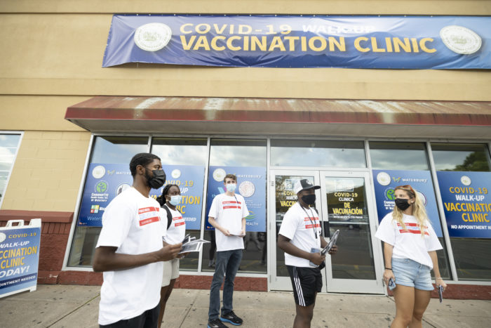 Quinnipiac University's Public Health College Corps workers canvass in Waterbury, Connecticut in efforts to convince hesitant young people to get vaccinated against COVID-19.